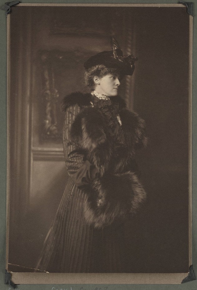 Photograph taken in Newport, Rhode Island, of author Edith Wharton, wearing hat with a feather, coat with fur trim, and a fur muff, 1907.