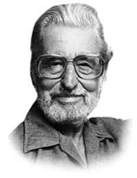 Dr Seuss looking at camera smiling, wearing glasses