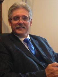 Dr .Roger M.  White