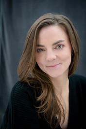 Headshot photo of author Emily Layden