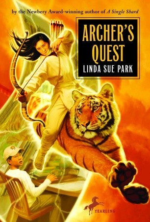 Book cover showing Kevin with a bow running alongside a tiger.