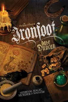 Ironfoot book cover (an old wooden tabletop strewn with spellbooks and spell components)