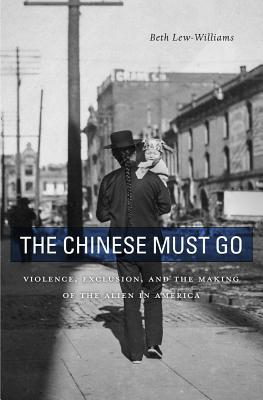 book cover of a Chinese man in 1920 suit alone on a street.