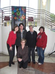 April 2, 2009 - Members of the <b>Mostly Literary Fiction Book Discussion Group</b>, based at the Hayward Public Library, at the Hayward Big Read Wrap Party. The Mostly Literary Fiction Book Discussion Group discussed <i><b>A Lesson Before Dying</b></i> at its March 2009 meeting.  Standing, from left to right: Loretta, Robin, Rita, and Michelle. Kneeling: Hayward Public librarian Sally Thomas