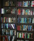 not the best picture but my regular Stephen King section starts on the bottom left shelf near the chair and then jumps to the next column at the top.  the top 2 shelves on the right.