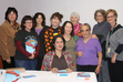The Hayward Public Library was pleased to host <b>Nafisa Haji</b>, author of <b><i>The Writing on My Forehead</i></b> on Nov. 4, 2009. Pictured here are members of the Mostly Literary Fiction Book Group with Nafisa Haji (seated). The Mostly Literary Fiction Book Group will be discussing The Writing on My Forehead at their Feb. 8, 2010 meeting.