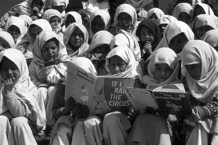 Students at Gultori Girls War Refugee school reading books sent by Patsy Collins, a Seattle philanthropist, who passed away in 2003. Patsy was a huge supporter of Greg Mortenson's effort to educated girls and promote literacy in rural areas of Pakistan and Afghanistan.