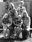 Lois Duncan, age 40, with her family -- front row: husband Don Arquette with Donnie, Lois with Kait, and Robin; back row, Kerry and Brett.