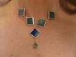 Just started soldering, so much fun! These are little squares of stained glass, framed in solder, with silver jumprings soldered onto them, sterling chain