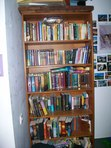 This is my bookcase in my room. i took this picture like three months ago. since then i probably got 20 new books.....