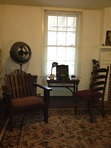 This is the room where Faulkner outlined the plot of <i>A Fable</i> around the walls as he worked on the book.  The writing desk was given to him when he was quite young by his mother, Maude.  The old Underwood was one that folded into a case.  A travel tag indicates the typewriter made it to Hollywood and back.  Notice the huge Vornado fan.  Faulkner refused to have airconditioning installed in Rowan Oak.  There's a small window unit in Estelle's bedroom.  She had it delivered the day after Faulkner was buried. *Koff*  The merry widow.