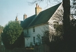 """Monk's House, Rodmell, was the Woolfs' house from 1919 until their deaths. It was mainly a summer house and served as a refuge for Virginia Woolf from the busy city of London. Virginia Woolf set out from Monk's House on March 28, 1941 and drownded herself in the river Ouse. The son of ferrier still lived in Rodmell in 2005 when I took this picture being on a study trip to the village.  """"Back from Monk's an hour ago, after the first weak end--the most perfect, I was going to say, but how can I tell what week ends we mayn't spend there...The first pure joy of the garden I mean. Wind enough outside; within sunny & sheltered; & weeding all day to finish the beds in a queer sort of enthusiam which made me say this is happiness.  (The Diary of Virginia Woolf, 1920)"""