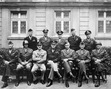 """<b>Senior American commanders of World War II.</b>  <u>Seated are (from left to right)</u>  Gens. William H. Simpson, George S. Patton, Carl A. Spaatz, Dwight D. Eisenhower, Omar Bradley, Courtney H. Hodges, and Leonard T. Gerow;  <u>Standing are (from left to right): </u>  Gens. Ralph F. Stearley, Hoyt Vandenberg, Walter Bedell Smith, Otto P. Weyland, and Richard E. Nugent.  Original caption: """"""""This is the brass that did it."""