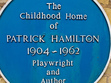 """Patrick Hamilton was one of the most gifted and admired writers of his generation. Born Anthony Walter Patrick Hamilton in the Sussex village of Hassocks, in 1904, he and his parents moved to 12 First Avenue, Hove, when Patrick was four, and this house is where he spent his early years.   Patrick Hamilton's childhood home is situated near the bottom, at the the southerly end, of First Avenue.  His house, number 12, is the last yellow brick house before a row of houses painted cream.  First Avenue ends opposite Hove seafront.  Patrick Hamilton achieved early success as a novelist and playwright, his first novel published in his early twenties. He wrote several other novels and a play, Rope, before he was thirty. Both Rope and another play, Gaslight, were adapted for the big screen, the former by Alfred Hitchcock. His novels include Craven House, The Midnight Bell, The Siege of Pleasure, The Plains of Cement (a trilogy later published together under the title Twenty Thousand Streets Under the Sky), Hangover Square and The Slaves of Solitude, and The West Pier (described by Graham Greene as the best book ever written about Brighton and Hove). Patrick died in 1962, aged fifty-eight, alcoholism undoubtedly a factor in his early death.   12 First Avenue, Hove, East Sussex, England is marked by a blue plaque that was paid for by Penguin Books.  The plaque states: """"Childhood Home of Patrick Hamilton, 1904-1962, Playwright and Author"""""""