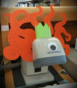 Barry Scanilow, the royally cephalopodic barcode scanner of the Adult Reference Desk.
