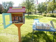 Little Free Library - a small box containing books; anyone can take a book free and return it or another one, or return the book to a different LFL; it's to spread literacy and community