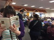 Cait reads Americanah while waiting for Amy Klobuchar at a Townhall Meeting.