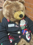 Full of holiday good cheer and stylish as ever, Betty Bear continues to welcome readers to Moffat Library.